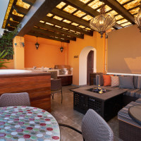 Rooftop terrace with view of sitting area, fire pit, kitchenette, jacuzzi